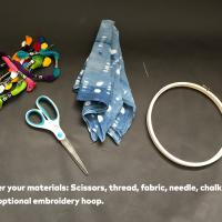 Step 1: Gather your materials: scissors, thread, fabric, needle, chalk/pencil and an optional embroidery hoop.