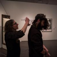 Viviane Le Courtois collecting hair to weave into the Global Thinking Pod