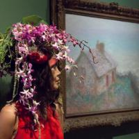 A model with a floral headdress from the Adornment performance by Arthur Williams