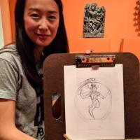 a woman holding a drawing of Shiva she drew in the Linking Asia exhibition
