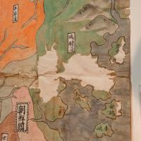 close up of Korea showing loss of copper colorant and an old repair