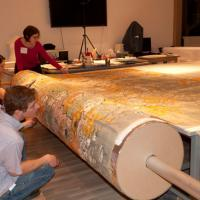 Staff rolling the map onto the Sono tube