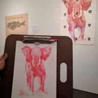 drawing of a poster with a red elephant on it in the Stampede exhibition