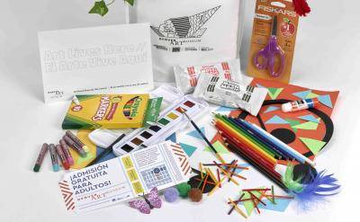 Creativity Kits made by the Denver Art Museum which includes crayons, paints, colored pencils, scissors, construction paper, and other crafting supplies