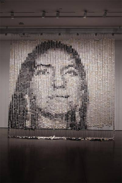 Large beaded installation that shows the image of a face