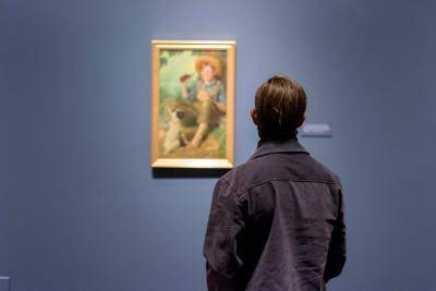 Man looking at impressionist painting