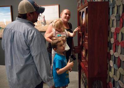 A family of four enjoying the museum galleries