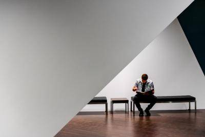 Man sitting and reading on a bench in the galleries