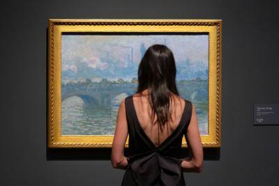 Woman looking at Monet painting