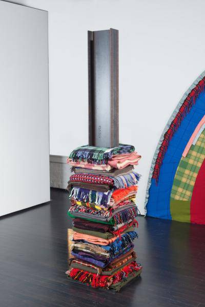 Colorful patterned blankets stacked like a tower