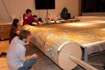 The conservation staff working on a large map