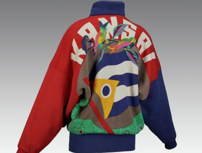 a jacket photographed from the back with the word Kansai and birds and colorful shapes