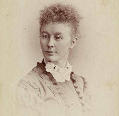 Old photograph of a woman, Helen Dill, from the neck up looking off to the side