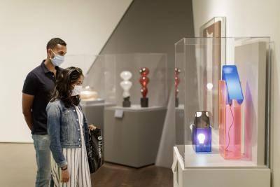 Visitors looking at art at the Denver Art Museum