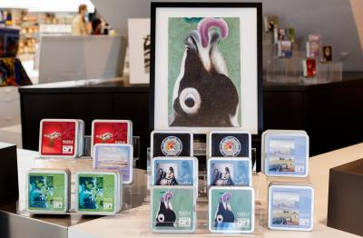 boxes of puzzles for sale in the museum shop with a large photo of a Georgia O'Keeffee painting of a cow with its tongue out
