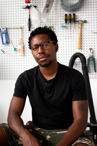 Portrait of the artist Simphiwe Ndzube at his studio