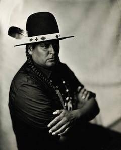 Black and white photo of artist Gregg Deal