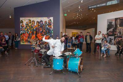 Adán De La Garza and Ryan Wade Ruehlen performing on drums in the Stampede gallery at the 2018 Materials Frequency Untitled Final Friday event.