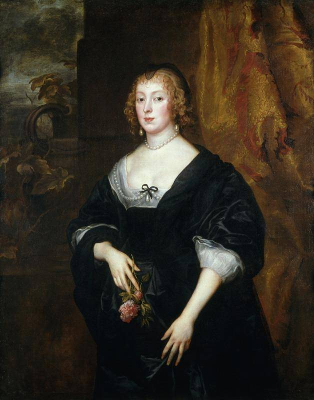 Woman in black dress standing for portrait