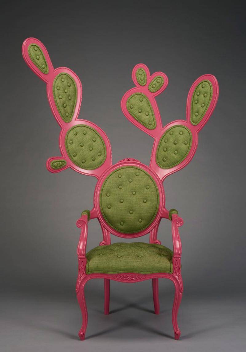 A pink and green chair designed to be in the shape of a cactus