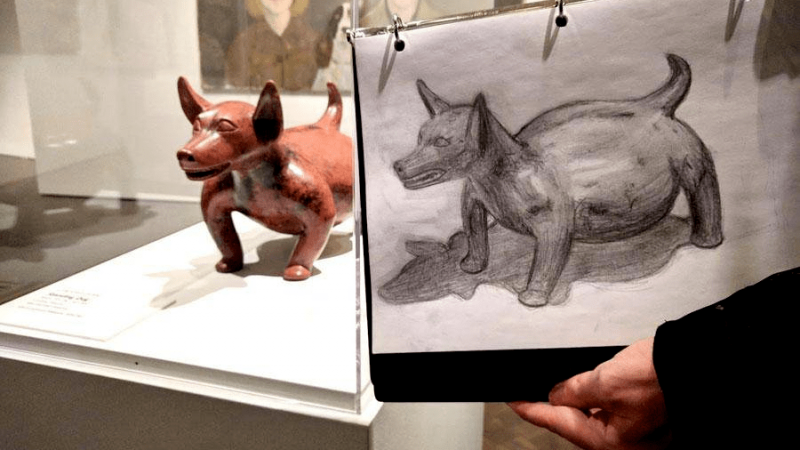 photo of a drawing of a dog statute by a student at a drop-in drawing class in Stampede