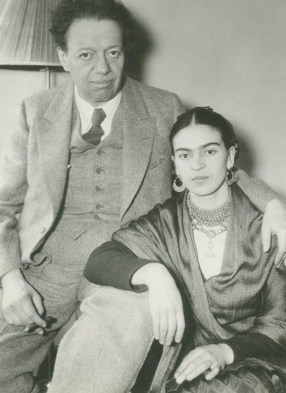 Black and white photograph of Diego Rivera and Frida Kahlo in side-by-side embrace