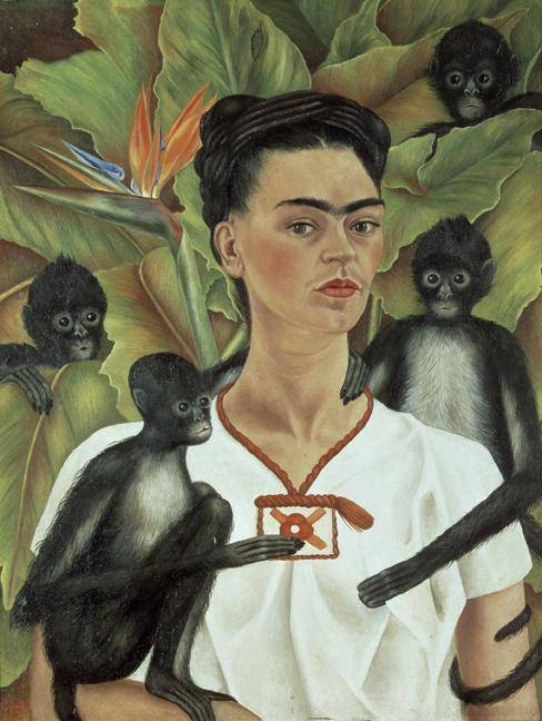 Frida Kahlo from the waist up with a monkey sitting on her arm