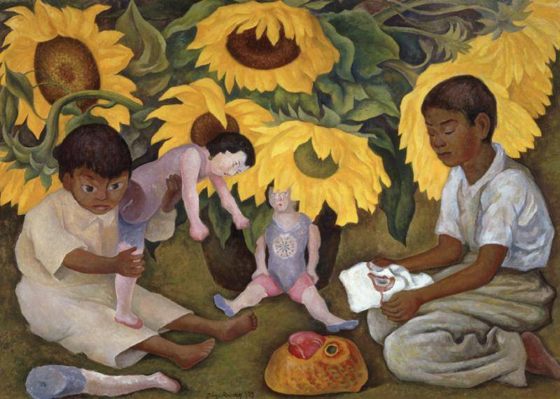 Two young kids playing with toys in a field of giant sunflowers