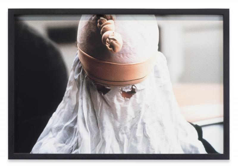A woman hidden behind a white cloth sheet