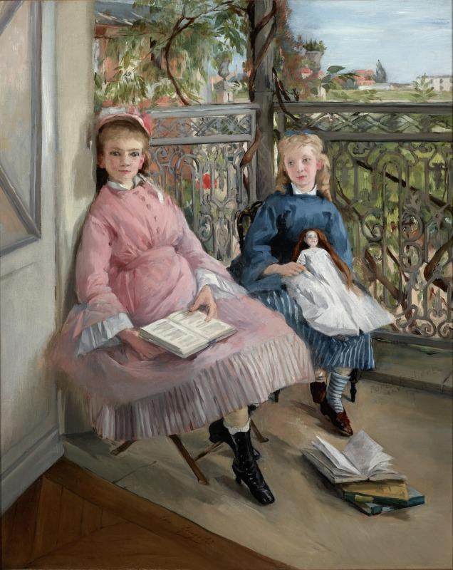 Two young girls sitting by the window