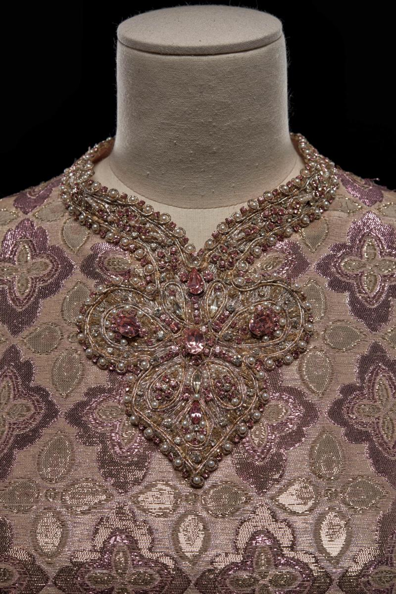 Close-up look at the intricate beading along a dress's neckline