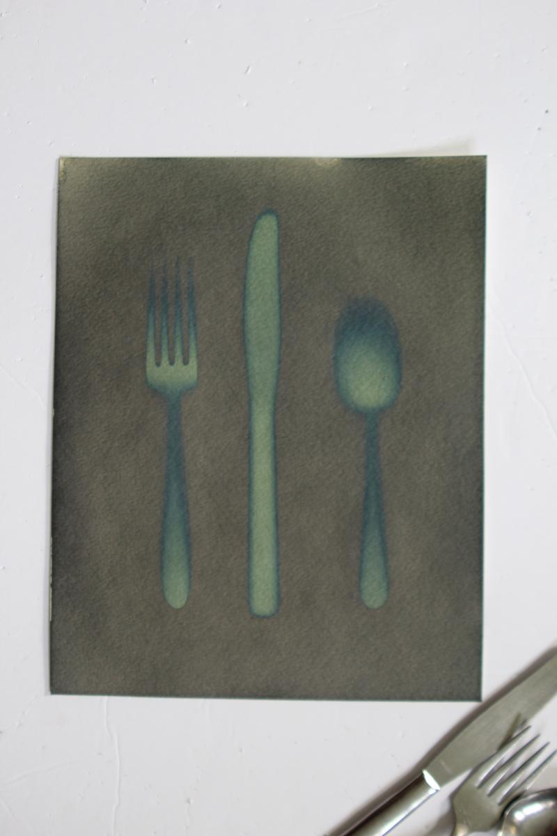 Print of a silver fork, knife, and spoon