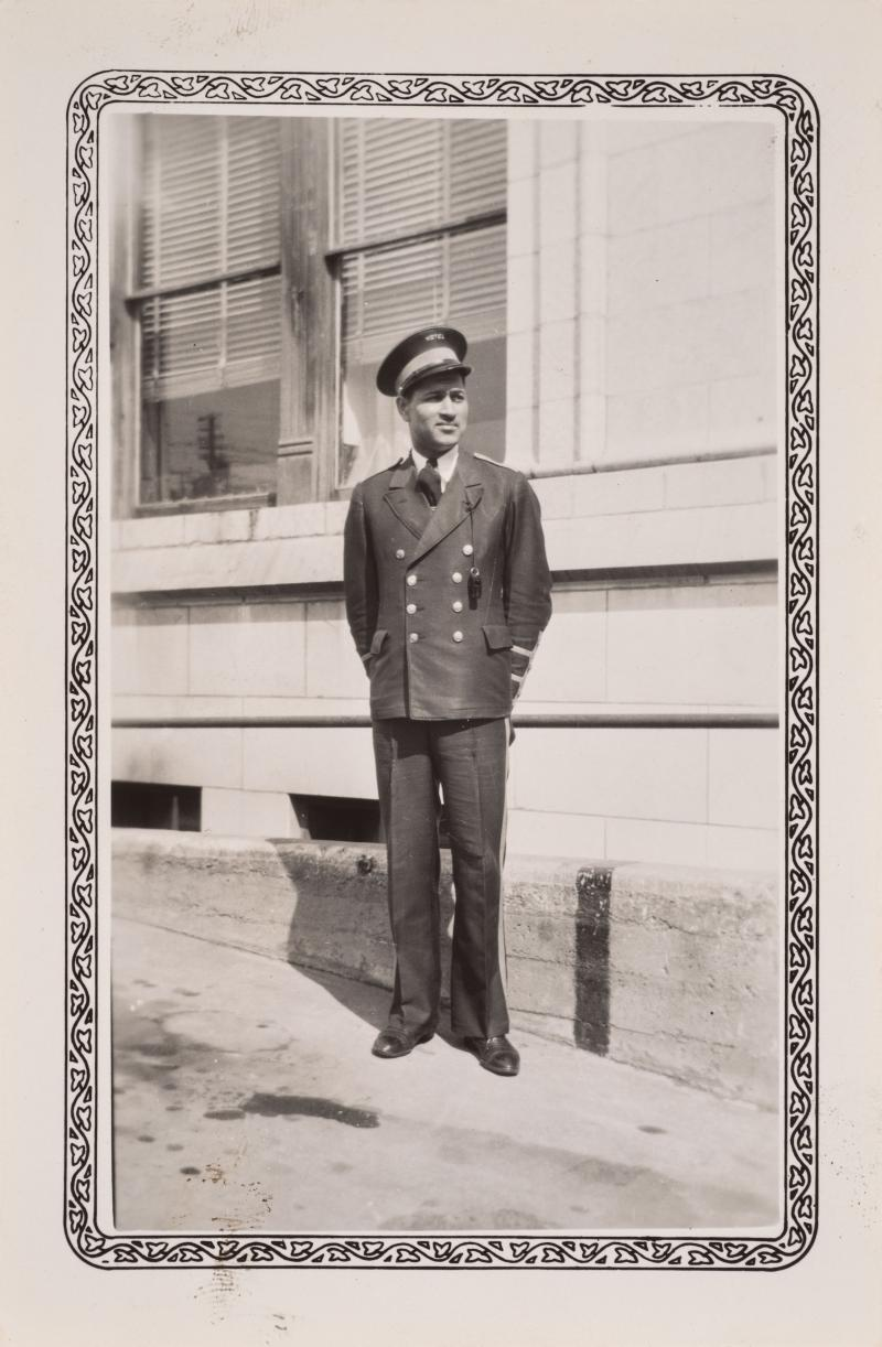 a man in a bell captain uniform outside the hotel