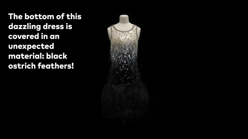 The bottom of this dazzling dress is covered in an unexpected material: black ostrich feathers.