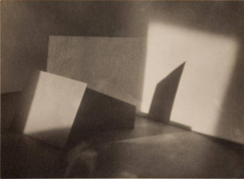 Abstract sepia-toned photograph of light and shadows in an empty room