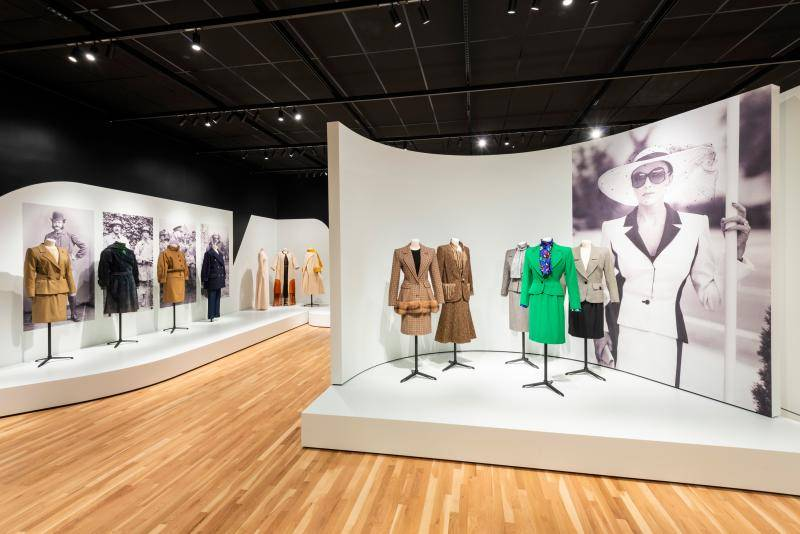 Interior shot of the Suited gallery with mannequins displaying various garments