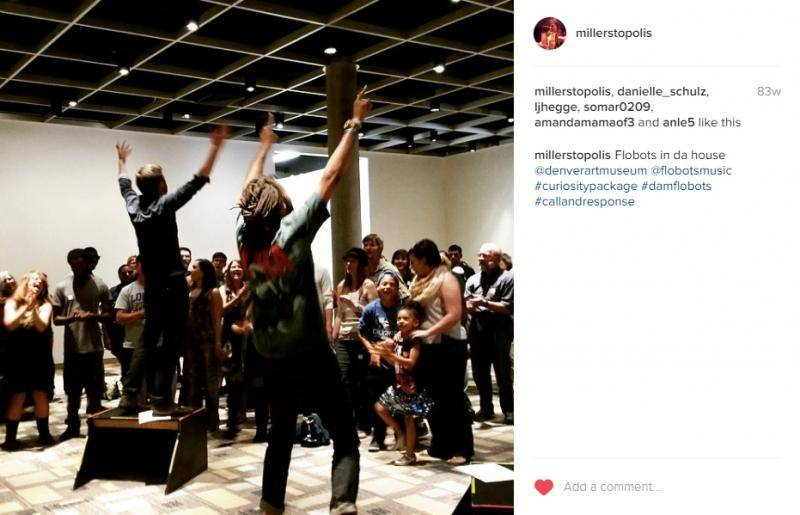 Instagram photo of the Flobots interacting with visitors at the Denver Art Museum.