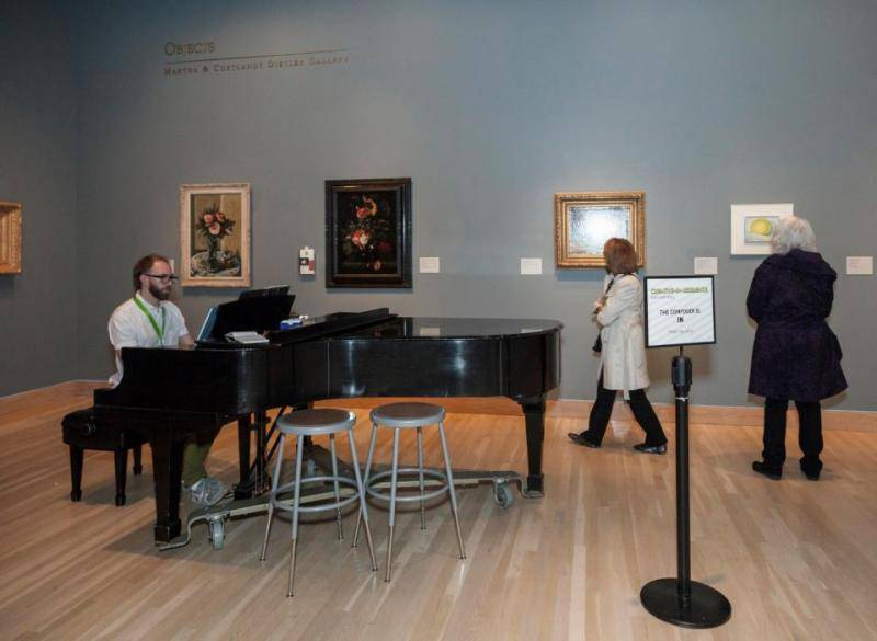 """Nathan Hall's """"piano office"""" in the European and American art collection's Still Life Gallery at the Denver Art Museum."""