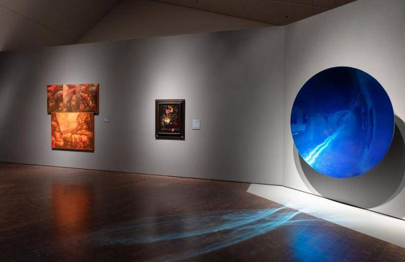 three artworks in The Light Show including large blue disc