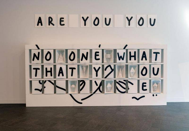 "Text installation that reads ""Are you you"""