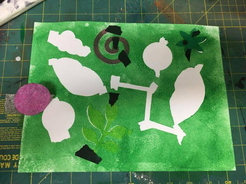 Cut out shapes are removed from the paper and reveal negative space.